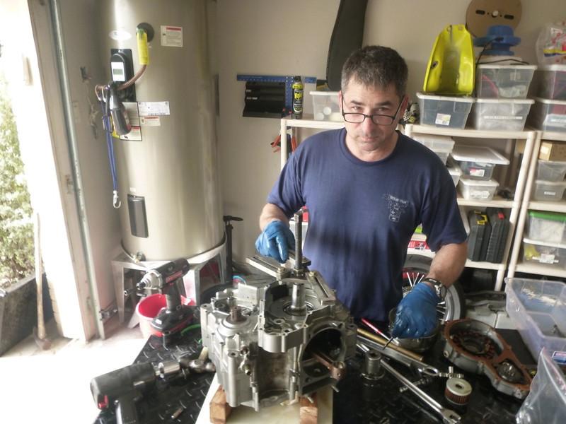 Erik is working on Jenn's engine.
