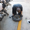 Tire changing on the Baja.  The first puncture on the trip.
