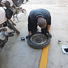 Changing a tire on the Baja - the first flat of the trip.