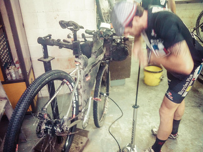 Kevin getting a new tire setup at the Outdoorsman bike shop in Butte.