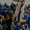 Photo by Aaron Beckman  <br /> <br /> Pierce's Taggart Bailey jumps over Caleb Gebhardt of Lutheran High Tuesday night in Pierce.