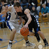 Photo by Aaron Beckman  <br /> <br /> Lutheran High's Kale Kucera attempts to drive past Pierce's Brady Starkel Tuesday night in Pierce.
