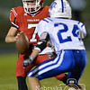 Hartington CC's James Kaiser gets ready to pitch the football Friday night against Eagle's Riley Berner. The Trojans beat the Eagles 41-13.<br /> Photo by Aaron Beckman