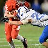 Photo by Aaron Beckman  <br /> <br /> Pierce's Mason Beckendahl attempts to wrap up Norfolk Catholic's Drew Leise Thursday night in Norfolk.