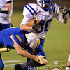 Eagle's Hunter Spier attempts to run through the arms of a West Holt defender Friday night in Atkinson. Lutheran High went on to beat the Huskies of West Holt 29-19.<br /> Photo by Aaron Beckman