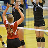O'Neill St Mary's Tracy Chvala attempts to bump the ball against Lutheran High's Gina Blackman(16) and Arianna Rathke(1) Thursday night in Norfolk. St. Marys went on to beat the Lady Eagles in 5 sets. <br /> Aaron Beckman / Correspondent