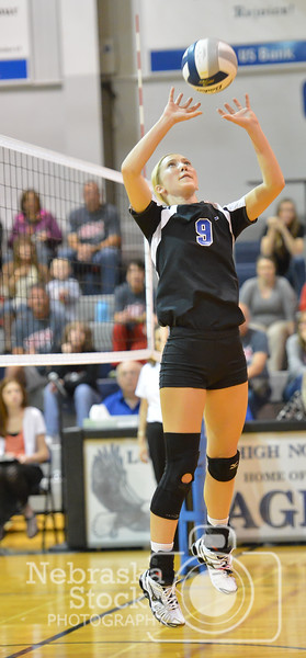 Lutheran High's Olivia Spence sets a ball Thursday night in Norfolk. The lady Eagles, lost to O'Neill St. Marys in 5 sets.  Aaron Beckman / Correspondent