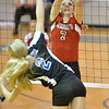 Lady Cardinal's Sydney Hupp goes up to block a spike against Lutheran High's Bridgett Knobbe Thursday night. The Lady Cardinals of O'Neill St. Marys went on to top the Lady Eagles in 5 sets.<br /> Aaron Beckman / Correspondent