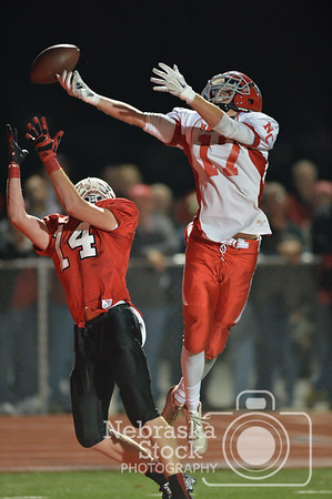 Norfolk Catholic's Matt Miller goes up for a pass against Boone Central / Newman Grove's Kyle Kramer Thursday night in Albion. The #1 Cardinals beat the #2 Knights, 32 - 16.  Photo by Aaron Beckman