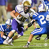 Battle Creek's  Derek Renner looks down at Eagle's defender Riley Berner Friday night in Norfolk. The Braves went on to beat Lutheran High 35-0. <br /> Photo by Aaron Beckman