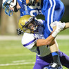 Brave's Jared Bellar tackles Eagle's Nate Stolze Friday night in Norfolk. Battle Creek went on to win against Lutheran High 35-0.<br /> Photo by Aaron Beckman