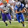 Brave's Jake Finkral runs down Lutheran High's quarterback Ayden Wiederin Friday night in Norfolk.  #1 Battle Creek went on to beat the Eagles, 35-0.<br /> Photo by Aaron Beckman