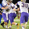 Brave's quarterback, Zach Bellar hands the ball off to Derek Renner Friday night in Norfolk. The #1 Braves went on to beat Lutheran High Eagles, 35-0.<br /> Photo by Aaron Beckman