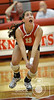 Norfolk Catholic's Cami Jones goes for a ball Monday night in Norfolk during Conference Volleyball. Catholic ended up losing to Wayne in four sets. <br /> Photo by Aaron Beckman