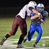 Lutheran High's Hunter Spier attempts to run through the hands of a Crofton Warrior defender Friday night in Norfolk. The Eagles of Lutheran High won over the Warriors 44-26.<br /> Photo by Aaron Beckman