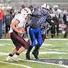Lutheran High's Josh Miller attempts to grab Crofton's quarterback Tanner Crosley Friday night in Norfolk. The Eagles went on to win over the Warriors 44-26<br /> Photo by Aaron Beckman
