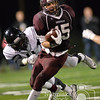 Photo by Aaron Beckman  <br /> <br /> Norfolk's Lane McCallum breaks away from Lincoln Northeast's Alonga Chol Friday night in Norfolk.