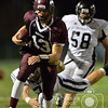 Photo by Aaron Beckman  <br /> <br /> Panther's quarterback Gunner Fuelberth outruns Lincoln Northeast's Jaden Kelly Friday night in Norfolk.