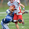 Photo by Aaron Beckman  <br /> <br /> Cedar Catholic's Tanner Keiser attempts to break a tackle from Lutheran High's Riley Berner Friday afternoon in Norfolk.