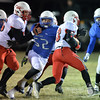 Photo by Aaron Beckman  <br /> <br /> Guardian Angel's Luke Gnad fights off a block to get a hold of Friend's Zemua Baptista Tuesday night in Beemer. The Blue Jay's topped the Bulldogs of Friend 46-26.