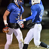 Photo by Aaron Beckman  <br /> <br /> Guardian Angel's Tanner Hass and Tanner Ortmeier congratulate each other after a touchdown in the 3rd quarter Tuesday night in Beemer. The Blue Jay's beat the Friend Bulldogs 46-26.