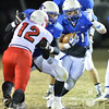 Photo by Aaron Beckman  <br /> <br /> Guardian Angel's Jesse Prieto runs around a block Tuesday night  against the Friend Bulldogs in Beemer. The Blue Jay's went on to beat the Bulldogs 46-26.