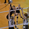 Photo by Aaron Beckman  <br /> <br /> Stuart's Courtni Kunz spikes the ball around a couple of Mullen defenders Thursday night during the first round of the Nebraska State Volleyball tournament. Stuart swept Mullen in three sets.