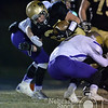 Photo by Aaron Beckman  <br /> <br /> David City's Lane Napier runs through a couple of Battle Creek defenders Friday night in David City. The Monarchs defeated the Battle Creek Braves 31-20 at advice to the C2 Nebraska Football Championship game.
