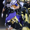Photo by Aaron Beckman  <br /> <br /> Battle Creek's Derek Renner gets wrapped up by a David City defender Friday night in David City during the C2 semi finals of the State playoffs. David City ended the Braves season by defeating them 31-20.