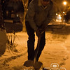 Photo by Aaron Beckman  <br /> <br /> Don Davis from Norfolk scoops snow off his sidewalk late Saturday night. Norfolk received its first real snow accumulations Saturday.