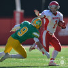 Photo by Aaron Beckman  <br /> <br /> Norfolk Catholic's Dylan Kautz attempts to stiff arm Columbus Scotus's Cole Harrington Tuesday in Lincoln during the C1 Championship game.