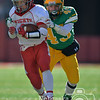 Photo by Aaron Beckman  <br /> <br /> Norfolk Catholic's Dylan Kautz attempts to outrun Columbus Scotus's Matt Strecker Tuesday in Lincoln during the C1 Championship game.
