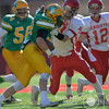 Photo by Aaron Beckman  <br /> <br /> Norfolk Catholic's Matt Miller attempts to take down Columbus Scotus's Jake Bos Tuesday down in Lincoln during the C1 Championship game.