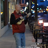 Photo by Aaron Beckman  <br /> <br /> Chad Barnhill, owner of Midwest Music, plays Christmas music with his ukulele Tuesday night in front of Midwest Music during the Downtown Riverpoint Christmas Festival.