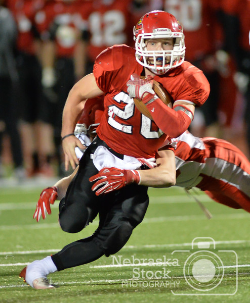 Photo by Aaron Beckman  <br /> <br /> Boone Central/Newman Grove's Wyatt Mazour attempts to break a tackle Friday night in Albion during the quarter finals of the C1 Nebraska State Football Playoffs against Norfolk Catholic. The Cardinals went on to beat the Knights 23-17.