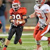 Photo by Aaron Beckman  <br /> <br /> Boone Central/Newman Grove's Joseph Brugger runs away from Norfolk Catholic's Nate Flaherty Friday night during the C1 quarter finals of the Nebraska State Football Playoffs. The Cardinals tops the Knights of Norfolk Catholic 23-17.