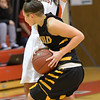 Photo by Aaron Beckman  <br /> <br /> Northeast's Megan Trinder attempts to block the path of Cloud County's Breannah Bretches Thursday night in Norfolk.
