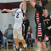 Photo by Aaron Beckman  <br /> <br /> Neligh's Grant White attempts to block a jump shot by Creighton's Reid Liska, Friday night in Neligh.