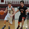 Photo by Aaron Beckman  <br /> <br /> Neligh's Grant White dribbles around Creighton's Reid Liska Friday night in Neligh.