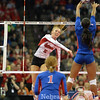 Photo by Aaron Beckman  <br /> <br /> Nebraska's Amber Rolfzen attempts to spike a ball against Kansas Tiana Dockery in the 3rd set Thursday night in Omaha.
