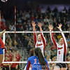 Photo by Aaron Beckman  <br /> <br /> Husker's Amber Rolfzen (5) and Kelly Hunter go up for a block against Kansas in the 1st set Thursday night in Omaha.