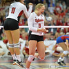 Photo by Aaron Beckman  <br /> <br /> Nebraska's Cecilia Hall (9) and Kenzie Maloney(11) celebrate the winning point in their fourth set against Kansas Thursday night.