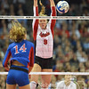Photo by Aaron Beckman  <br /> <br /> Nebraska's Cecilia Hall attempts to block a spike against Kansas's Madison Rigdon Thursday night in Omaha.