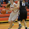Photo by Aaron Beckman  <br /> <br /> Norfolk Catholic's Hailey Lammers drives through Lutheran High's Beth Skoglund Thursday night in Norfolk.