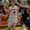 Photo by Aaron Beckman  <br /> <br /> Norfolk Catholic's Joelle Heng drives around Lutheran High's Bridgett Knobbe Thursday night in Norfolk.