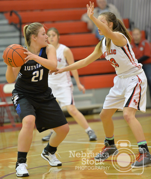 Photo by Aaron Beckman  <br /> <br /> Lutheran High's Gina Blackman attempts to keep the ball away from Norfolk Catholic's Bailey Ehlers Thursday night in Norfolk.