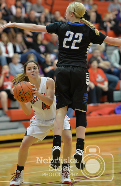 Photo by Aaron Beckman  <br /> <br /> Norfolk Catholic's Joelle Heng passes the ball underneath Lutheran High's Bridgett Knobbe Thursday night in Norfolk.