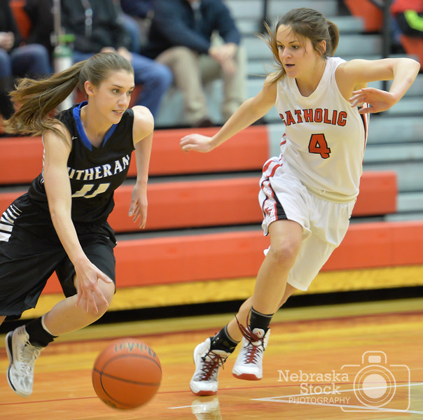 Photo by Aaron Beckman  <br /> <br /> Lutheran High's Ari Rathke attempts to drive around Norfolk Catholic's Joelle Heng Thursday night in Norfolk.