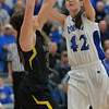 Photo by Aaron Beckman  <br /> <br /> Ponca's Abigail VanDyke attempts to shoot over Emerson-Hubbard's Tessa Stewart Friday night in Ponca.