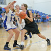 Photo by Aaron Beckman  <br /> <br /> Emerson-Hubbard's Maddie Martin attempts to drive to the hoop against Ponca's Hannah Albrecht Friday night in Ponca.